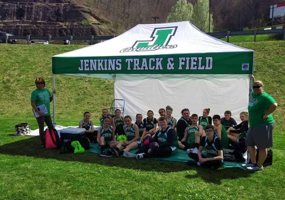 10x15 track and field tent with team underneath